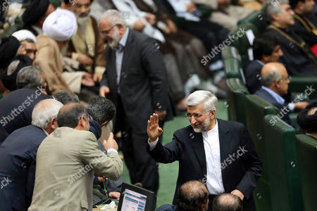 "Saeed Jalili Iran's top nuclear negotiator, Saeed Jalili, who was a candidate of the June 14 presidential election, waves as he attends the swearing-in ceremony of the new President, Hasan Rouhani, at the parliament in Tehran, Iran, . Rouhani replaced Mahmoud Ahmadinejad, who was in power since 2005. Rouhani on Sunday called on the West to abandon the ""language of sanctions"" in dealing with his country over its contentious nuclear program, hoping to ease the economic pressures now grinding its people"