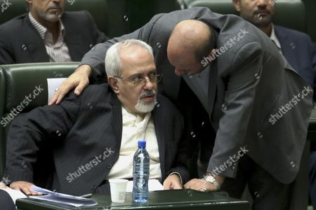 Mohammad Javad Zarif, Hossein Dehghan Mohammad Javad Zarif, center, nominee for Iranian foreign minister, left, listens to Hossein Dehghan, nominee for defense minister, in a session of the parliament to debate on President Hasan Rouhani's proposed Cabinet in Tehran, Iran, . Iran's proposed foreign minister said the country should have a productive role in the international level