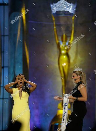 Nina Davuluri, Mallory Hagan Miss New York Nina Davuluri, left, reacts after winning the Miss America 2014 pageant as Miss America 2013 Mallory Hagan approaches her, in Atlantic City, N.J