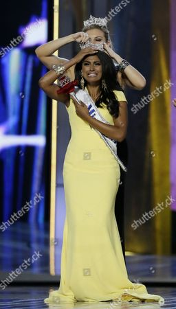 Mallory Hagan Miss New York Nina Davuluri, front, is crowned as Miss America 2014 by Miss America 2013 Mallory Hagan, in Atlantic City, N.J