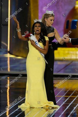 Stock Image of Nina Davuluri, Mallory Hagan Miss New York Nina Davuluri, left, reacts after being crowned Miss America 2014 by Miss America 2013 Mallory Hagan, in Atlantic City, N.J