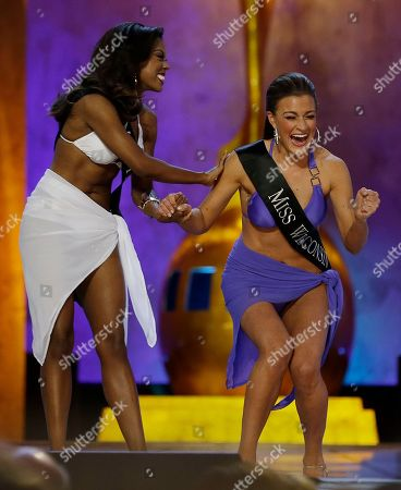 Paula Mae Kuiper, Ivana Hall Miss Wisconsin Paula Mae Kuiper, right, reacts after finding out she's advancing beyond the lifestyle round as Miss Texas Ivana Hall congratulates her during the Miss America 2014 pageant, in Atlantic City, N.J