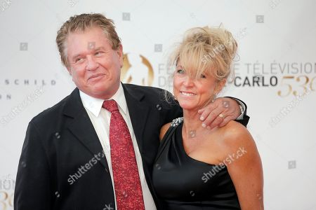 Stock Picture of Tom Berenger, Laura Moretti Tom Berenger and Laura Moretti pose for photographers during the opening ceremony of the 2013 Monte Carlo Television Festival, in Monaco