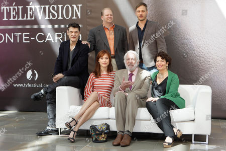 """Gabriella Pession, Edward Bernero, Rola Bauer,Donald Sutherland, Marc Lavoine, Tom Wlaschita From left at rear, actors Marc Lavoine, producer Edward Bernero, actor Tom Wlaschiha, and from left in foreground, actors Gabriella Pession, Donald Sutherland and executive producer Rola Bauer from the television series """"Crossing Lines"""" pose for photographers during the 2013 Monte Carlo Television Festival, Monday, June 10, 2013, in Monaco"""