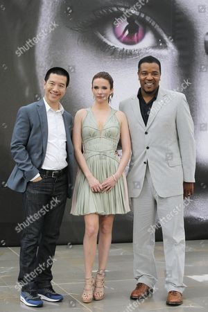 """Left to right, actors Reggie Lee and Bitsie Tulloch and Russell Hornsby of TV series """"Grimm"""" poses for photographers during the 2013 Monte Carlo Television Festival, in Monaco"""