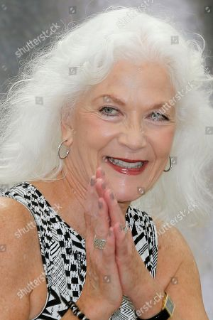 Linda Thorson Actress Linda Thorson gestures as she poses for photographers during the 2013 Monte Carlo Television Festival, in Monaco