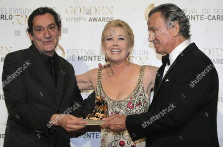 Director Agusti Villaronga, left, poses with his Golden Nymph Awards with Melody Scott Thomas and Eric Braeden during the closing ceremony of the 2013 Monte Carlo Television Festival, in Monaco