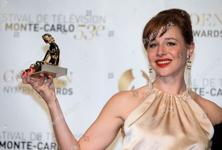 Actress Eszter Onodi of Hungary poses with her Golden Nymph Award during the closing ceremony of the 2013 Monte Carlo Television Festival, in Monaco