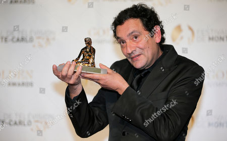 Director Agusti Villaronga poses with his Golden Nymph Awards during the closing ceremony of the 2013 Monte Carlo Television Festival, in Monaco