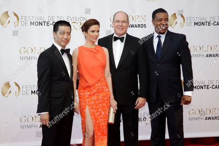 Prince Albert II of Monaco poses with left to right, actors Reggie Lee, Betsie Tulloch, and Russell Hornsby during the closing ceremony of the 2013 Monte Carlo Television Festival, in Monaco