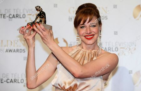 Actress Eszter Onodi of Hungary poses with her Golden Nymph Awards during the closing ceremony of the 2013 Monte Carlo Television Festival, in Monaco
