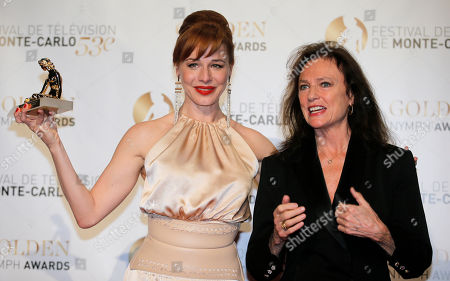 Actress Eszter Onodi of Hungary poses with her Golden Nymph Award with Jacqueline Bisset, during the closing ceremony of the 2013 Monte Carlo Television Festival, in Monaco