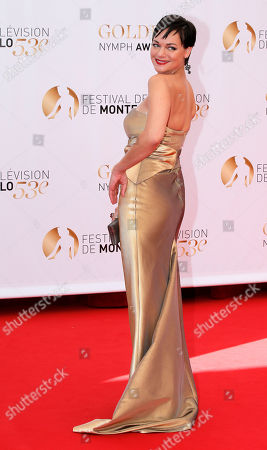US actress Crystal Allen poses for photographers during the closing ceremony of the 2013 Monte Carlo Television Festival, in Monaco