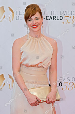 Actress Eszter Onodi of Hungary poses for photographers during the closing ceremony of the 2013 Monte Carlo Television Festival, in Monaco