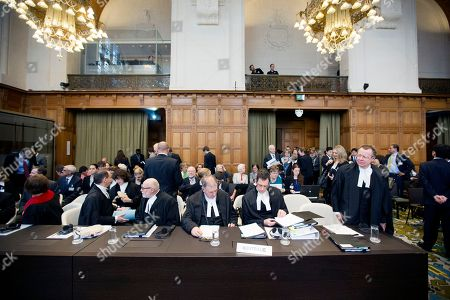 Australian delegation from right: General Counsel Bill Campbell, Solicitor General Justin Gleeson, Professor James Crawford, Solicitor Henry Burmester, Professor Philippe Sands, Professor Laurence Boisson de Chazournes at the International Court of Justice (ICJ) in The Hague, Netherlands, . Australia is urging the United Nations' highest court to ban Japan's annual whale hunt. Lawyers for Australia will argue at the ICJ on Wednesday that Japan harpoons minke whales each year in the icy waters around Antarctica in breach of a 1986 moratorium on commercial whaling. Japan will respond next week by telling judges that the hunt is for scientific research and is allowed under the 1946 International Convention for the Regulation of Whaling. The court will take months to issue a final and binding decision