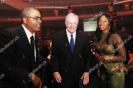 """On, Demola Seriki, left, Steve Forbes, Editor-in-Chief of Forbes Media, center, and Mo Abudu, chief executive officer of EbonyLife TV, attends the launch of Africa's first global black entertainment network in Lagos, Nigeria. Mo Abudu, who could be considered Africa's Oprah Winfrey, is launching an entertainment network that will be beamed into nearly every country on the continent with programs showcasing its burgeoning middle class. Mosunmola """"Mo"""" Abudu wants EbonyLife TV to inspire Africans and the rest of the world, and change how viewers perceive the continent"""