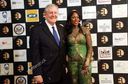 """Steve Forbes, Editor-in-Chief of Forbes Media, left, and Mo Abudu, chief executive officer of EbonyLife TV pose for photographers during the launch of Africa's first global black entertainment network in Lagos, Nigeria. Mo Abudu, who could be considered Africa's Oprah Winfrey, is launching an entertainment network that will be beamed into nearly every country on the continent with programs showcasing its burgeoning middle class. Mosunmola """"Mo"""" Abudu wants EbonyLife TV to inspire Africans and the rest of the world, and change how viewers perceive the continent"""