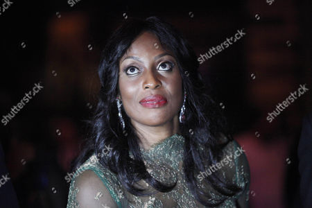 """On, Mo Abudu, chief executive officer of EbonyLife TV, attends the launch of Africa's first global black entertainment network in Lagos, Nigeria. Mo Abudu, who could be considered Africa's Oprah Winfrey, is launching an entertainment network that will be beamed into nearly every country on the continent with programs showcasing its burgeoning middle class. Mosunmola """"Mo"""" Abudu wants EbonyLife TV to inspire Africans and the rest of the world, and change how viewers perceive the continent"""