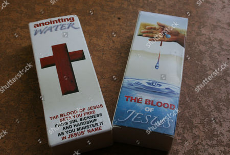 """Anointing water is photographed in Johannesburg, South Africa. T.B. Joshua's Synagogue, Church of All Nations has branches around the world, and a recent YouTube video even credits him with predicting the disappearance of Malaysian Airlines Flight MH370. Joshua is one of the best-known preachers in Africa and among the most profitable in Nigeria, the go-to faith healer and spiritual guide for leaders such as the late Ghanaian president John Atta Mills, Malawian president Joyce Banda and former Zimbabwean prime minister Morgan Tsvangirai. The man who says he comes from the poor village of Arigidi is worth between $10 and $15 million based on assets, according to Forbes magazine, which in 2011 estimated his personal wealth. The church holds some 15,000 people with outside tents for the overflow and Sunday services are beamed worldwide. Yet critics say this wildly popular televangelist hinders efforts to curtail the spread of HIV and tuberculosis with testimonies by church-goers that faith and his holy water can cure both. He is also accused of taking advantage of his followers and tightly controlling those closest to him, who call him """"Daddy"""