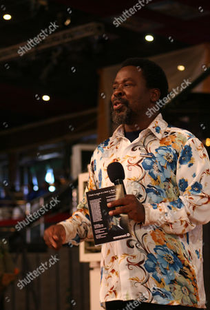 """T.B. Joahua T.B. Joshua conducts a service at the Synagogue, Church of All Nations, in Lagos Nigeria. T.B. Joshua's Synagogue, Church of All Nations has branches around the world, and a recent YouTube video even credits him with predicting the disappearance of Malaysian Airlines Flight MH370. Joshua is one of the best-known preachers in Africa and among the most profitable in Nigeria, the go-to faith healer and spiritual guide for leaders such as the late Ghanaian president John Atta Mills, Malawian president Joyce Banda and former Zimbabwean prime minister Morgan Tsvangirai. The man who says he comes from the poor village of Arigidi is worth between $10 and $15 million based on assets, according to Forbes magazine, which in 2011 estimated his personal wealth. The church holds some 15,000 people with outside tents for the overflow and Sunday services are beamed worldwide. Yet critics say this wildly popular televangelist hinders efforts to curtail the spread of HIV and tuberculosis with testimonies by church-goers that faith and his holy water can cure both. He is also accused of taking advantage of his followers and tightly controlling those closest to him, who call him """"Daddy"""