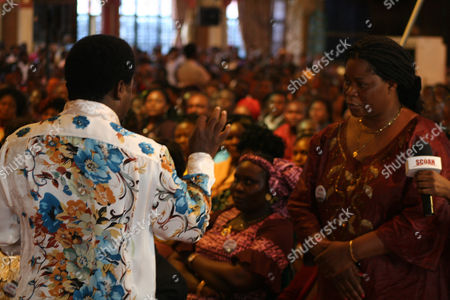 """T.B. Joshua T.B. Joshua, left, conducts a service at the Synagogue, Church of All Nations, in Lagos Nigeria. T.B. Joshua's Synagogue, Church of All Nations has branches around the world, and a recent YouTube video even credits him with predicting the disappearance of Malaysian Airlines Flight MH370. Joshua is one of the best-known preachers in Africa and among the most profitable in Nigeria, the go-to faith healer and spiritual guide for leaders such as the late Ghanaian president John Atta Mills, Malawian president Joyce Banda and former Zimbabwean prime minister Morgan Tsvangirai. The man who says he comes from the poor village of Arigidi is worth between $10 and $15 million based on assets, according to Forbes magazine, which in 2011 estimated his personal wealth. The church holds some 15,000 people with outside tents for the overflow and Sunday services are beamed worldwide. Yet critics say this wildly popular televangelist hinders efforts to curtail the spread of HIV and tuberculosis with testimonies by church-goers that faith and his holy water can cure both. He is also accused of taking advantage of his followers and tightly controlling those closest to him, who call him """"Daddy"""