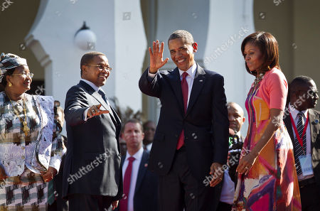 Barack Obama, Michelle Obama, Jakaya Kikwete, Salma Kikwete U.S. President Barack Obama, center-right, first lady Michelle Obama, right, Tanzanian President Jakaya Kikwete, center-left, and Tanzanian First Lady Salma Kikwete, left, arrive at State House in Dar es Salaam, Tanzania . Teeming crowds and blaring horns welcomed President Barack Obama to Tanzania's largest city, where the U.S. president's likeness is everywhere as he arrived on the last leg of his three-country tour of the African continent
