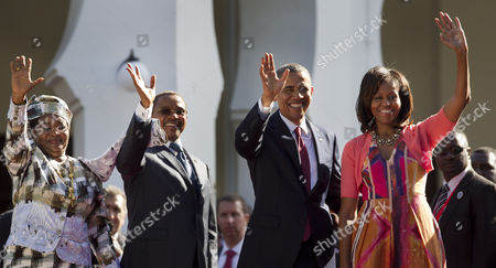 Barack Obama, Michelle Obama, Jakaya Kikwete, Salma Kikwete U.S. President Barack Obama, center-right, first lady Michelle Obama, right, Tanzanian President Jakaya Kikwete, center-left, and Tanzanian First Lady Salma Kikwete, left, wave as they arrive at State House in Dar es Salaam, Tanzania . Teeming crowds and blaring horns welcomed President Barack Obama to Tanzania's largest city, where the U.S. president's likeness is everywhere as he arrived on the last leg of his three-country tour of the African continent