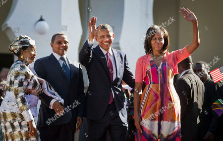 Barack Obama, Michelle Obama, Jakaya Kikwete, Salma Kikwete U.S. President Barack Obama, center-right, and first lady Michelle Obama, right, wave as they enter State House accompanied by Tanzanian President Jakaya Kikwete, center-left, and Tanzanian First Lady Salma Kikwete, in Dar es Salaam, Tanzania . Teeming crowds and blaring horns welcomed President Barack Obama to Tanzania's largest city, where the U.S. president's likeness is everywhere as he arrived on the last leg of his three-country tour of the African continent