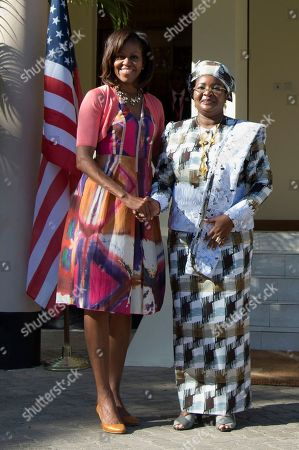 Michelle Obama, Salma Kikwete First lady Michelle Obama and Tanzanian first lady Salma Kikwete stand together to be photographed at the State House, in Dar es Salaam, Tanzania