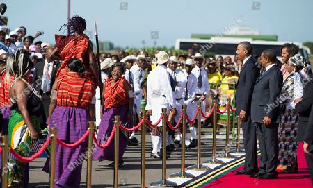 Barack Obama, Michelle Obama, Jakaya Kikwete, Salma Kikwete President Barack Obama, accompanied by first lady Michelle Obama, Tanzanian President Jakaya Kikwete, and his wife Salma Kikwete, watch as a group perform during an arrival ceremony at Julius Nyerere International Airport in Dar Es Salaam, Tanzania, . The president is traveling in Tanzania on the final leg of his three-country tour in Africa