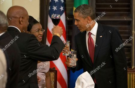 Barack Obama, Jakaya Kikwete President Barack Obama toasts with Tanzanian first lady Salma Kikwete during an official dinner at the State House in Dar Es Salaam, Tanzania, . The president is traveling in Tanzania on the final leg of his three-country tour in Africa