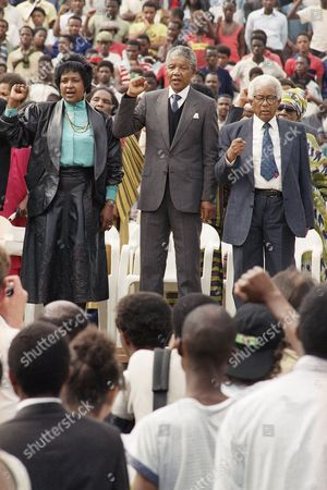 Stock Picture of Winnie Mandela, Nelson Mandela, Walter Sisulu African National Congress leader Nelson Mandela, flanked by his wife, Winnie, and Walter Sisulu appears before the fully-packed Soccer City Stadium in Soweto, South Africa, where he made his first address in his hometown since his release from prison. Sisulu was one of seven people sentenced with Mandela to life in prison for sabotage and plotting to overthrow the white government in what was known as the Rivonia treason trial. Sisulu died in 2003. South Africa's president Jacob Zuma says, that Mandela has died. He was 95