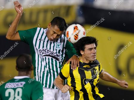 Julio Caceres, Diego Peralta Diego Peralta of Colombia's Atletico Nacional, left, heads the ball against Julio Caceres of Paraguay's Guarani during a Copa Sudamericana soccer game in Asuncion, Paraguay