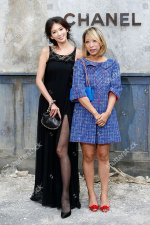 Lin Chi-ling, Mika Ninagawa Actres Lin Chi-ling, left, and photographer Mika Ninagawa pose for photographers as they arrive to attend Chanel's Haute Couture Fall-Winter 2013-2014 collection, presented in Paris