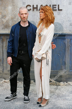 Rihanna, Mel Ottenberg Singer Rihanna, right, and Mel Ottenberg pose for photographers as they arrive to attend Chanel's Haute Couture Fall-Winter 2013-2014 collection, presented in Paris