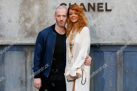 Stock Picture of Rihanna, Mel Ottenberg Singer Rihanna, right, and Mel Ottenberg pose for photographers as they arrive to attend Chanel's Haute Couture Fall-Winter 2013-2014 collection, presented in Paris