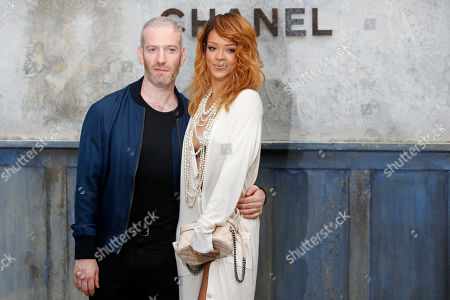 Stock Image of Rihanna, Mel Ottenberg Singer Rihanna, right, and Mel Ottenberg pose for photographers as they arrive to attend Chanel's Haute Couture Fall-Winter 2013-2014 collection, presented in Paris
