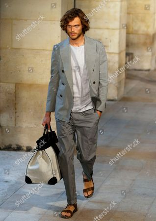 A model wears a creation by French fashion designer Veronique Nichanian as part of Hermes men's fashion Spring-Summer 2014 collection, presented in Paris