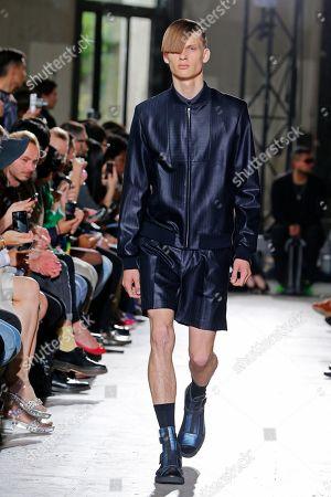 A model wears a creation by Japanese fashion designer Arashi Yanagawa for John Lawrence Sullivan's men's fashion Spring-Summer 2014 collection, presented in Paris