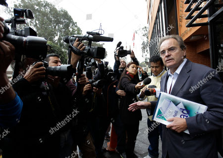 "Stock Image of Peter Madden British lawyer Peter Madden, right, who is representing Michaella McCollum Connolly, of Ireland, speaks to the media outside the National Police anti-drug headquarters where Connolly and Melissa Reid, of Britain, are being held after their detention in Lima, Peru, . Video emerged showing the two women being nervously interrogated after their Aug. 6 detention at Lima's airport for allegedly trying to smuggle cocaine on a flight to Spain. In the video, Reid says she was forced to take ""these bags"" in her luggage. She says she didn't know there were drugs inside them"