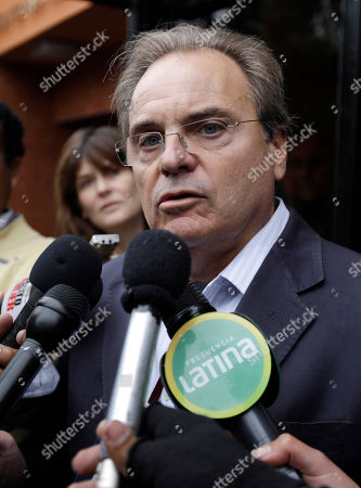 "Peter Madden British lawyer Peter Madden, who is representing Michaella McCollum Connolly, of Ireland, speaks to the press outside the National Police anti-drug headquarters where his client and her travel partner Melissa Reid, of Britain, are being held after their detention in Lima, Peru, . Video emerged showing the two women being nervously interrogated after their Aug. 6 detention at Lima's airport for allegedly trying to smuggle cocaine on a flight to Spain. In the video, Reid says she was forced to take ""these bags"" in her luggage. She says she didn't know there were drugs inside them"