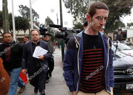 """Stock Photo of Peter Madden, Keith McCollum Connolly The brother of suspected drug smuggler Michaella McCollum Connolly, Keith, right, and her lawyer Peter Madden, second from the left, leave the National Police anti-drug headquarters where Michaella and her travel partner Melissa Reid, are being held, in Lima, Peru, . Video emerged showing the two women being interrogated after their Aug. 6 detention at Lima's airport for allegedly trying to smuggle cocaine on a flight to Spain. In the video, Reid says she was forced to take """"these bags"""" in her luggage. She says she didn't know there were drugs inside them"""