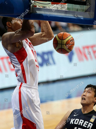 Stock Photo of Yi Jianlian, Lee Jong-hyun China's Yi Jianlian slams the ball to score against South Korea's Lee Jong-hyun during their FIBA Asia Basketball Championship at the Mall of Asia Arena at suburban Pasay city south of Manila, Philippines. South Korea won 63-59