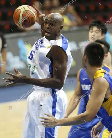Quincy Davis III Taiwan's Quincy Davis III, left, prepares to drive under the basket during their FIBA Asia Basketball Championship against Hong Kong at the Mall of Asia Arena at suburban Pasay city,south of Manila, Philippines. Chinese Taipei won 94-55