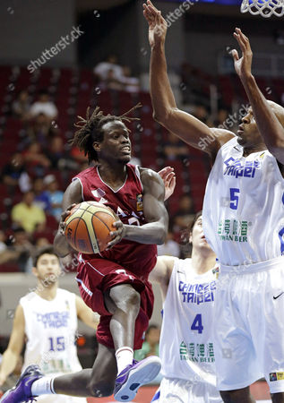Daoud Mosa Daoud, Quincy Davis III, Tseng Wen-Ting Qatar's Daoud Mosa Daoud (7) leaps high to pass the ball to a teammate as Taiwan's Quincy Davis III (5) and Tseng Wen-Ting (4) prepare to defend during their FIBA Asia Basketball Championship Wednesday Aug.7, 2013 at the Mall of Asia Arena at suburban Pasay city south of Manila, Philippines. Qatar won 71-68