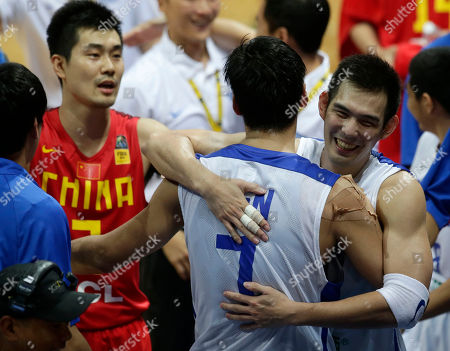 Tien Lei, Lu Cheng-Ju, Wang Shipeng Taiwanese players Tien Lei (7) and Lu Cheng-Ju, right, embrace following Taiwan's 96-78 win over China in their quarterfinals game of the FIBA Asia Basketball Championship at the Mall of Asia Arena at suburban Pasay city south of Manila, Philippines. At left is China's Wang Shipeng