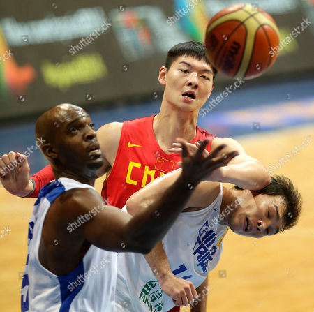 Wang Zhelin, Quincy Davis III, Tsai Wen-Cheng China's Wang Zhelin, center, and Taiwan's Quincy Davis III, left, and teammate Tsai Wen-Cheng, battle for the rebound during the first half of their quarterfinals game in the FIBA Asia Basketball Championship at the Mall of Asia Arena at suburban Pasay city south of Manila, Philippines