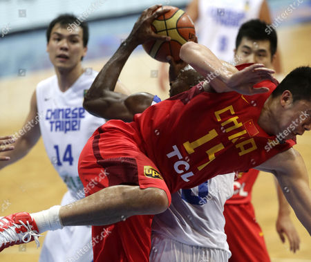 Wang Zhizhi, Quincy Davis III China's Wang Zhizhi (14) falls on a fake shot by Taiwan's Quincy Davis III during their quarterfinals game in the FIBA Asia Basketball Championship at the Mall of Asia Arena at suburban Pasay city south of Manila, Philippines. Taiwan won 96-78 to advance to a semi-finals game against Iran