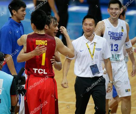 Wang Shipeng, Lin Chih-Chieh, Lu Cheng-Ju China's Wang Shipeng (7) congratulates Taiwan's Lin Chih-Chieh following Taiwan's 96-78 win over China in their quarterfinals game of the FIBA Asia Basketball Championship at the Mall of Asia Arena at suburban Pasay city south of Manila, Philippines. At right is Taiwan's Lu Cheng-Ju