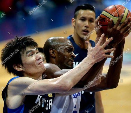 Stock Photo of Kim Joo-sung, Quincy Davis III, Lee Seung-jun South Korea's Kim Joo-sung (11) and Taiwan's Quincy Davis III battle for a rebound during their bronze medal game in the FIBA Asia Basketball Championship at the Mall of Asia Arena at suburban Pasay city, south of Manila, Philippines . South Korea won 75-57 to bag the Bronze and the third slot for the FIBA World Cup in Spain next year. In background is South Korea's Lee Seung-jun
